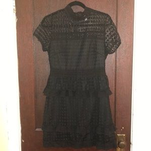 Little black dress with collar neck and ruffles